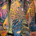 sean crane yellow koi sleeve tattoo