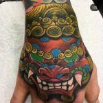 sean crane tattoo fu dog on hand